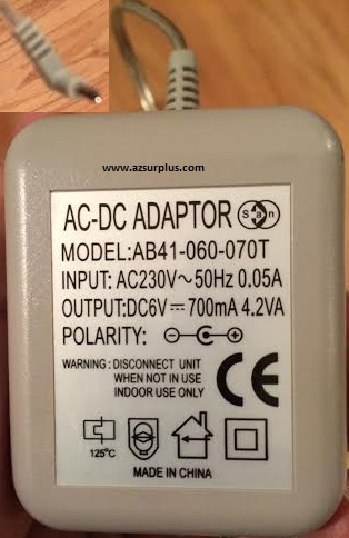 AB41-060-070T AC Adapter 6Vdc 700mA -(+) Used 1x3mm 90° UK Plug