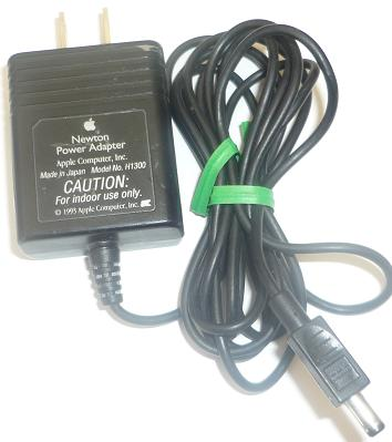 APPLE H1300 AC ADAPTER 7VDC 0.5A USED -(+) 1.5x4.5x9.4mm ROUND B