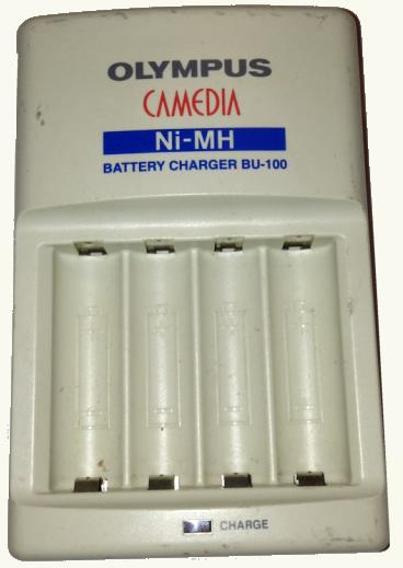 OLYMPUS BU-100 BATTERY CHARGER USED 1.2V 490mA CAMEDIA 100-240V